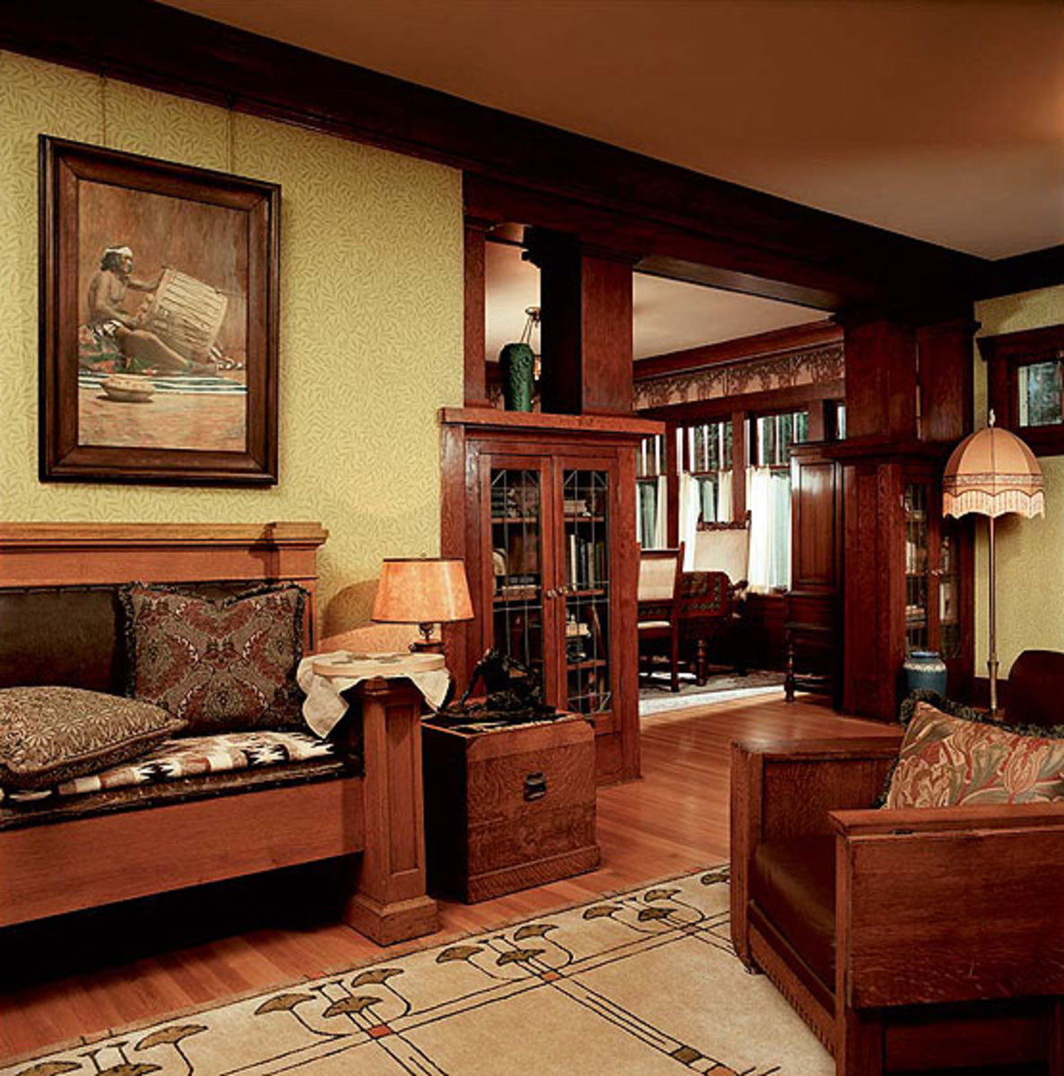 Even with the use of wallpaper and a papered frieze, patterned rug, and  collectibles
