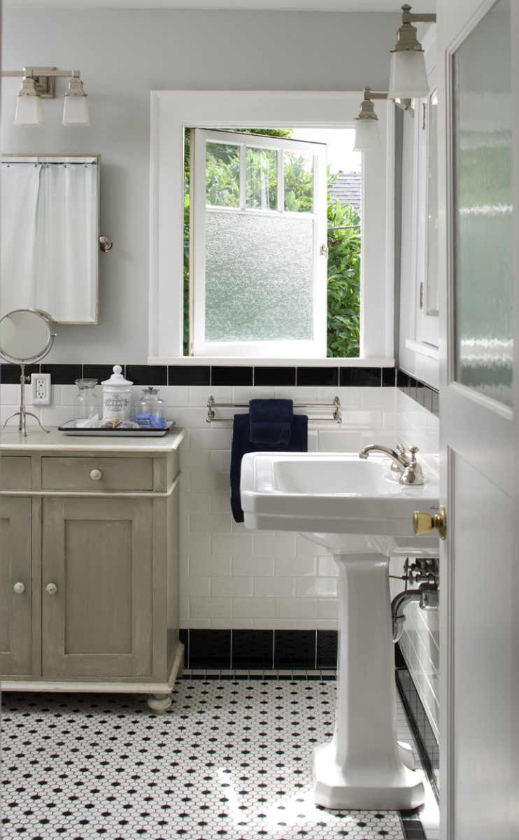 It may look untouched, but this bathroom in a 1927 Colonial Revival was stripped to the studs. The floor is classic black-and-white mosaic hex tile from American Olean. Photo: William Wright