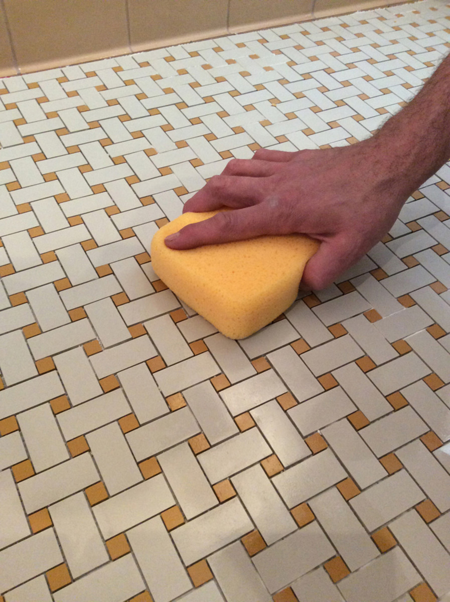 Remove excess grout with a sponge.