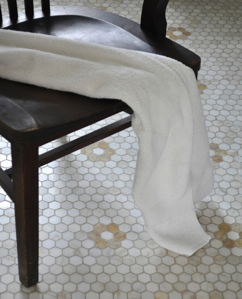 Hex tiles in 'Cloud Nine' and 'Honey Onyx' from New Ravenna unite to create a daisy design.
