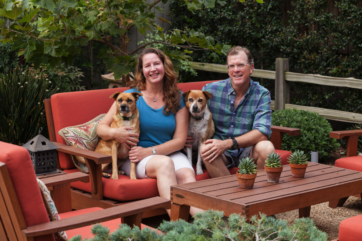 two homeowners with dogs