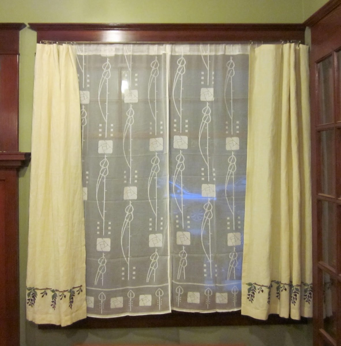 stenciled muslin panels over lace curtains