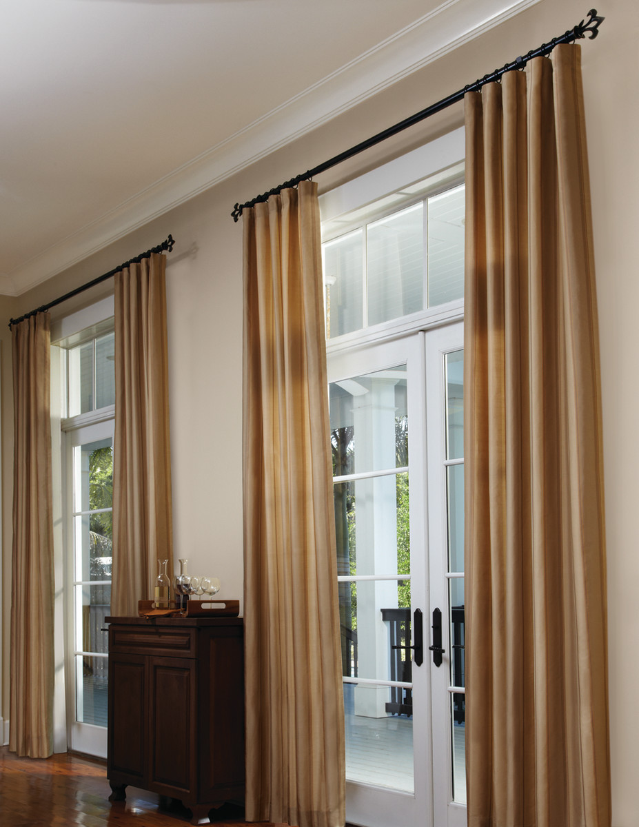 full length tan curtains on iron rods