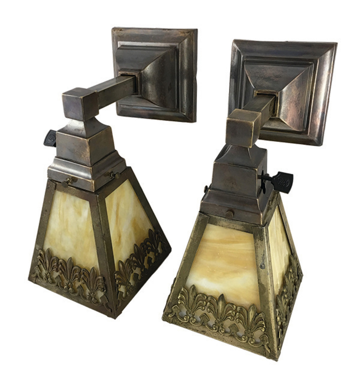 The folks at Historic Houseparts brushed up a pair of early 20th-century sconces by stripping later gold paint and cleaning brass underneath without damaging patina. The lights also got period-appropriate flat key sockets and new art-glass panels to replace missing glass.
