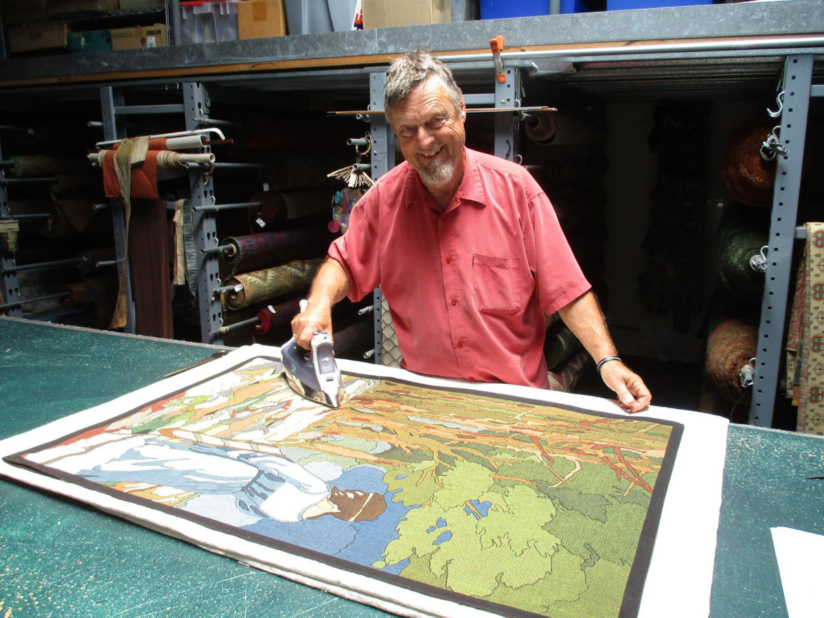 "Shown with the ""Forest Maiden"" tapestry is Paul Freeman, founder of Archive Edition Textiles."