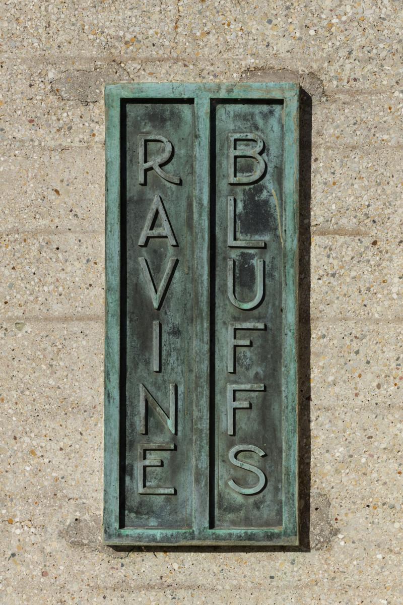 Original bronze plaques mark the entrance to Ravine Bluffs.