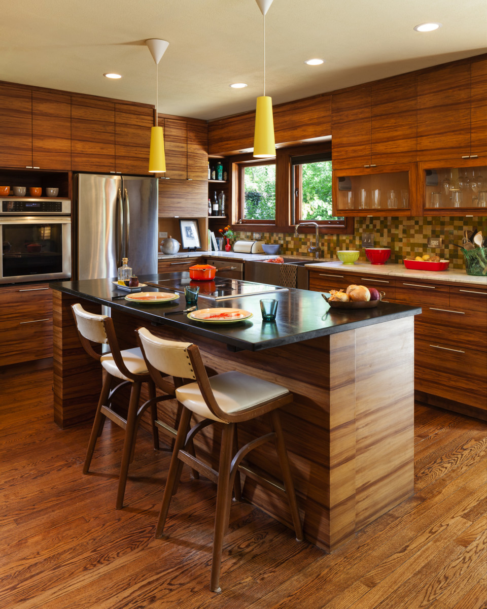 The new kitchen complements the Wright-designed house, with sweet gum cabinets and salvaged marble counters. The oak floor is original.