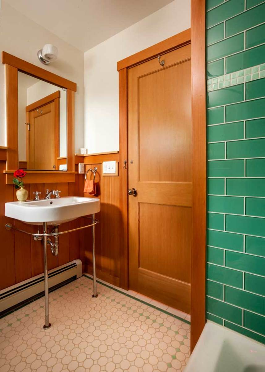 Green tiles are the complement to Douglas fir in a new bath. Photo: Blackstone Edge