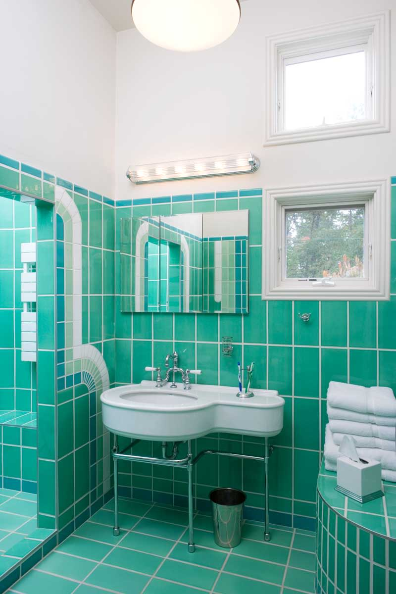 Large tiles in a period color set the tone in a renovated bath for a 1935 Art Deco house.  Photo: Jessie Walker