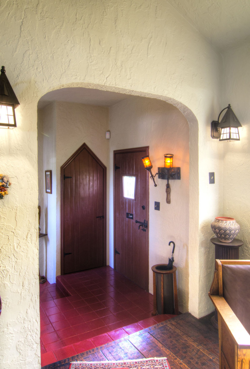 The foyer closet features an unusual pointed door.