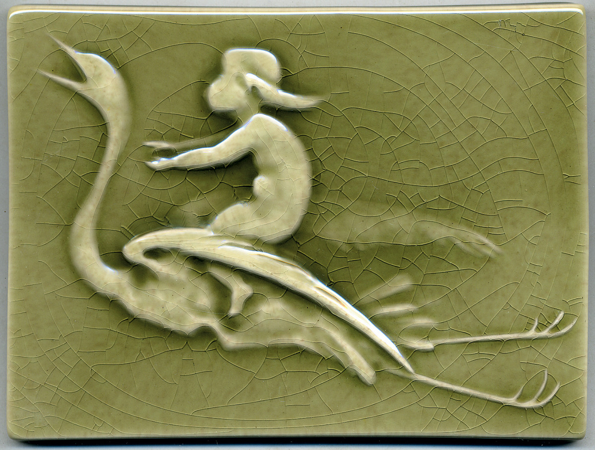 'Stork Delivering Baby' is a reproduction of a Low Art Tile by L'Esperance Tileworks, in fern green crackle glaze.