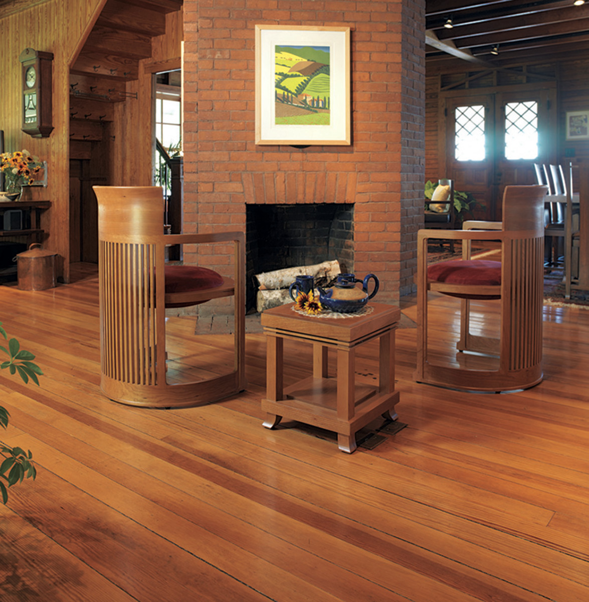 Floors more than a century old, like those in this Shingle Style cottage, tend to mellow over time to a desirable medium tone. Photo: Carolyn Bates