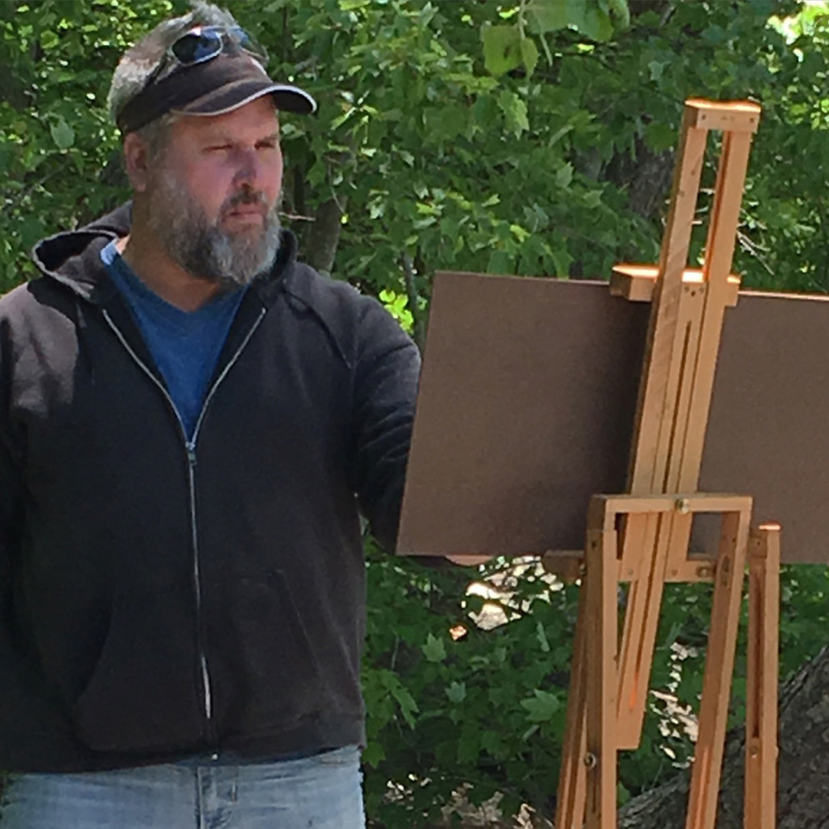 The artist Shawn Krueger paints on the shore of the French Broad River in Weaverville, North Carolina.