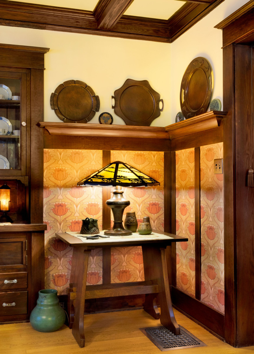 On a Limbert table sits a Limbert lamp with a reproduction shade by Luke Marshall. Copper trays are by van Erp and Avon.