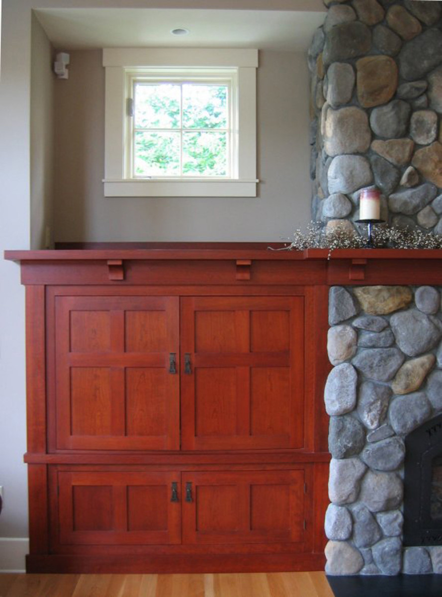 The design of the media cabinets flanking the new family room mimics the original woodwork.