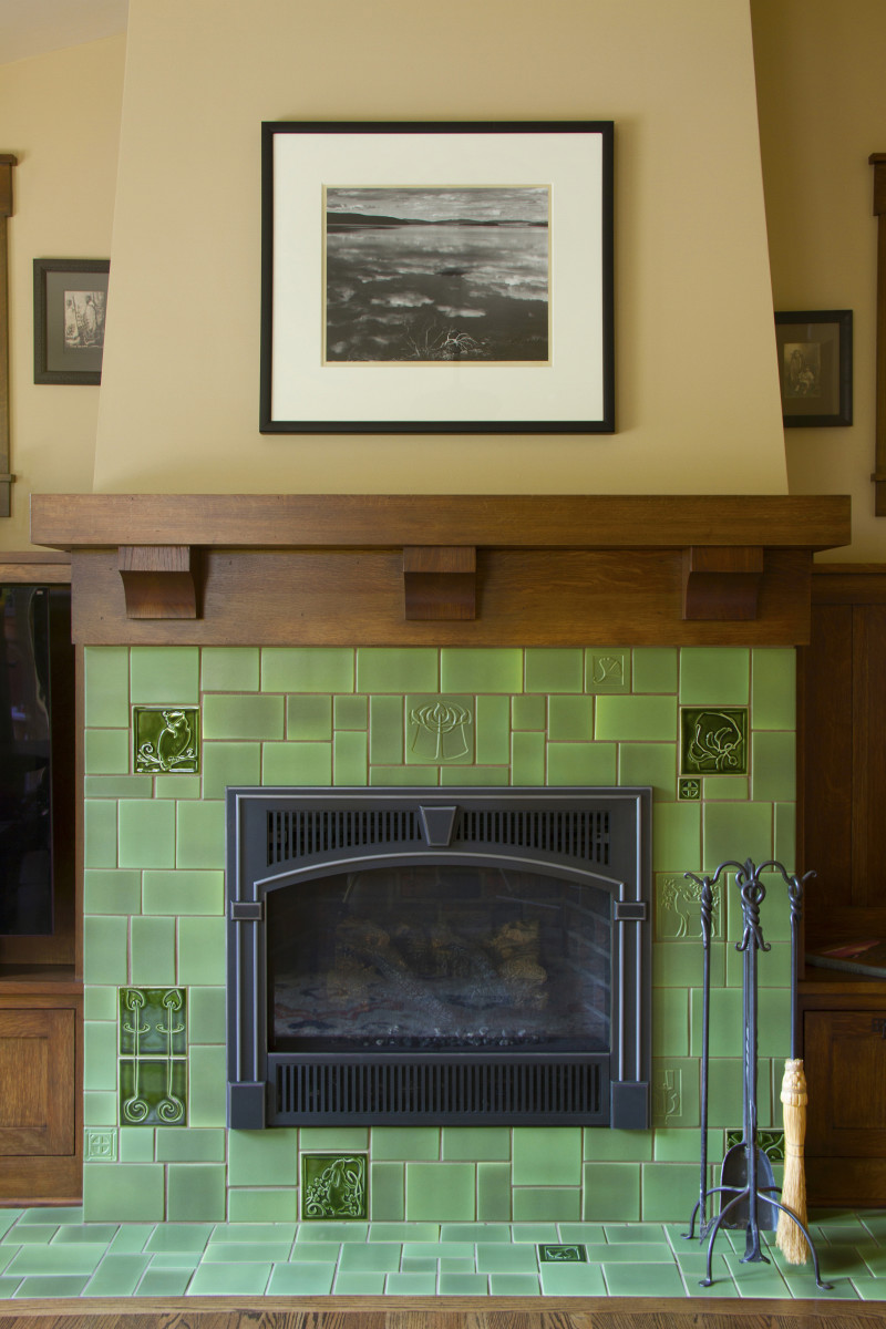 A fireplace installation using decorative tile by Carreaux du Nord.