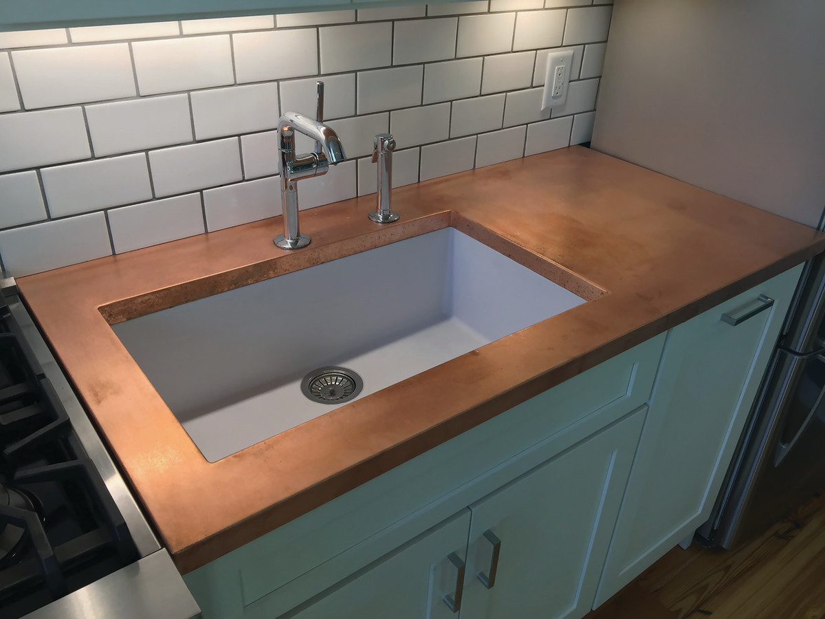A copper counter has an integrally welded sink.