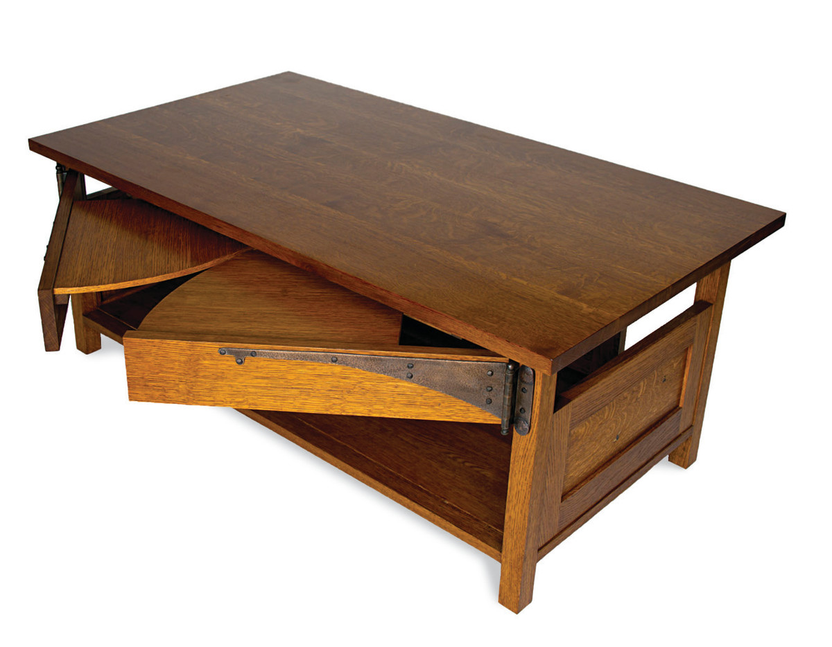 Built entirely from a single white oak tree from the owner's yard, Hiller's C.R. Ashbee-influenced coffee table conceals hidden, swing-out shelves.