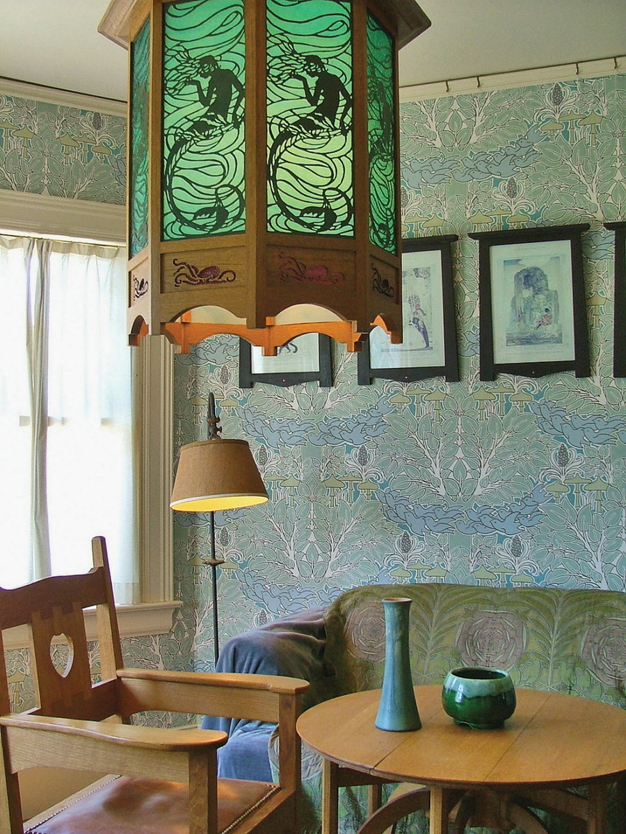 Berman printed the wallpaper and also made the Voysey-designed chair and lantern for this English Arts & Crafts room.