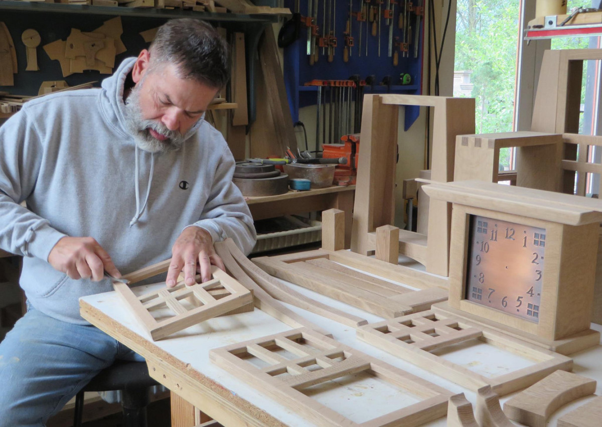 Clockmaker Jim Dailey hand sands individual pieces to exceptional luster.