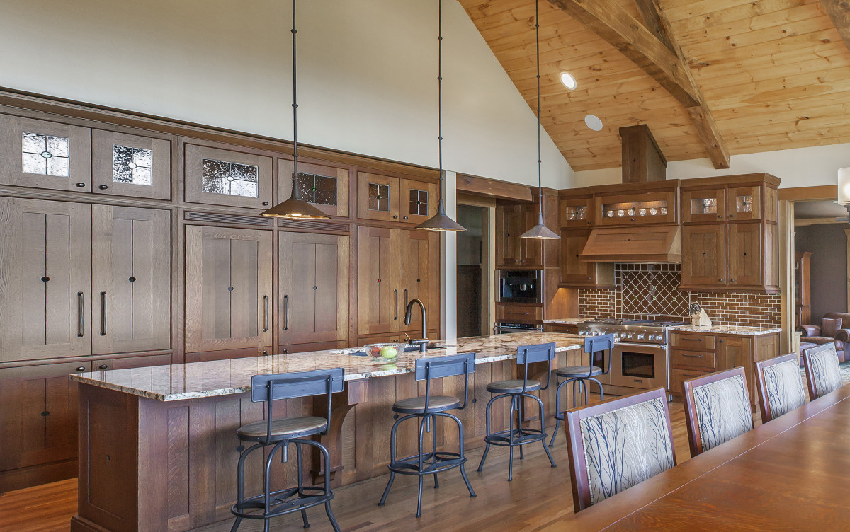 A recent, modern Arts & Crafts kitchen was built for a timber-frame house.