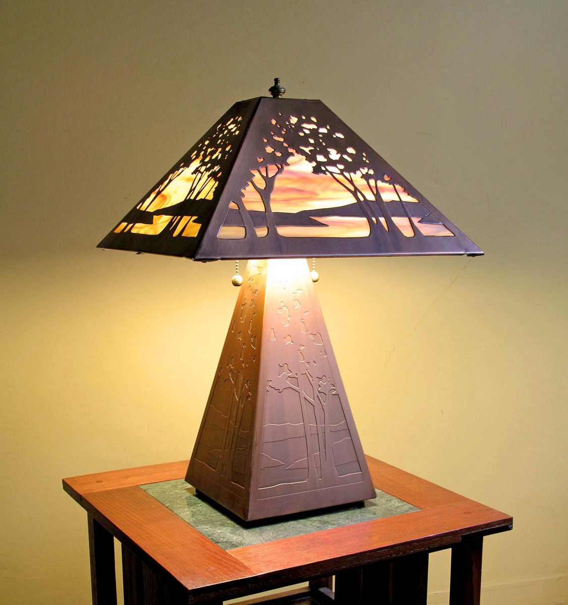 Trees, hills, and water in the 'Landscape' table lamp suggest the Pacific Northwest, where the artist was born.