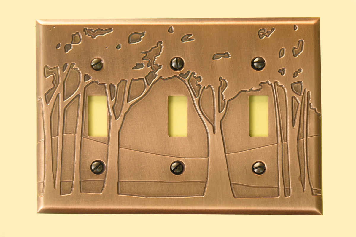 The etched copper switch plates come in Art Nouveau and Craftsman designs.