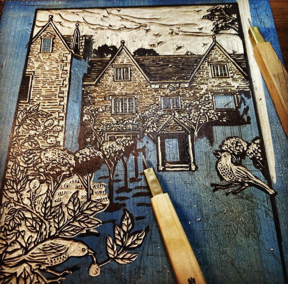 "Here she's carving the key block for the ""Kelmscott"" print."