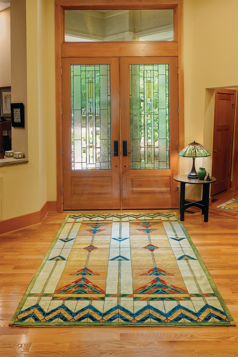 The 8 x 10 carpet is based on a stained glass window design.