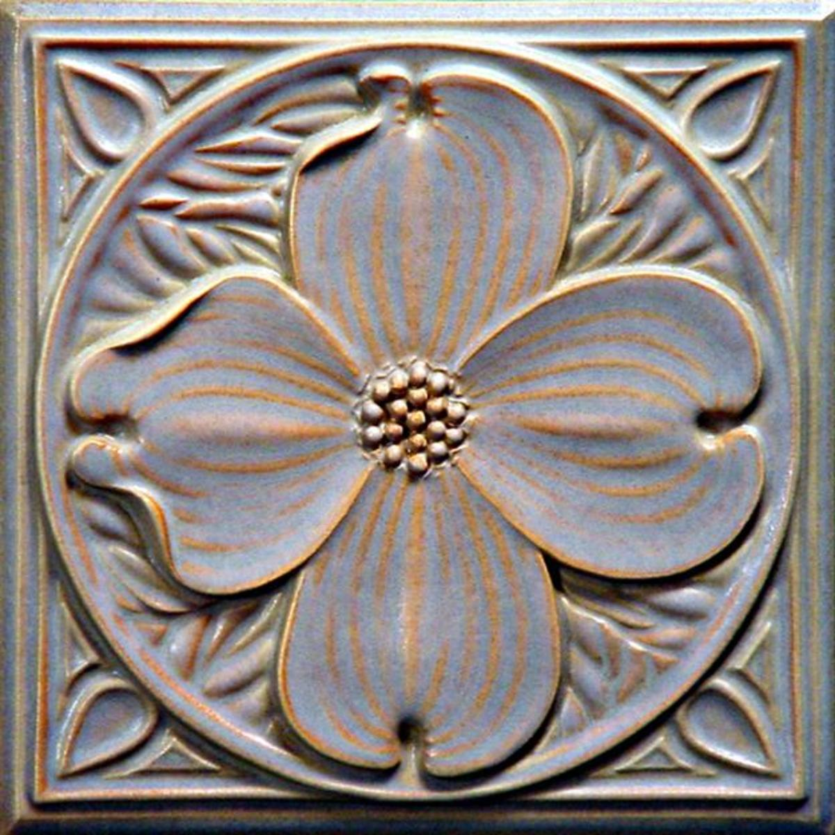 """This """"Dogwood"""" high-relief carved art tile is from Tudor Tile by Lewellyn Studio."""