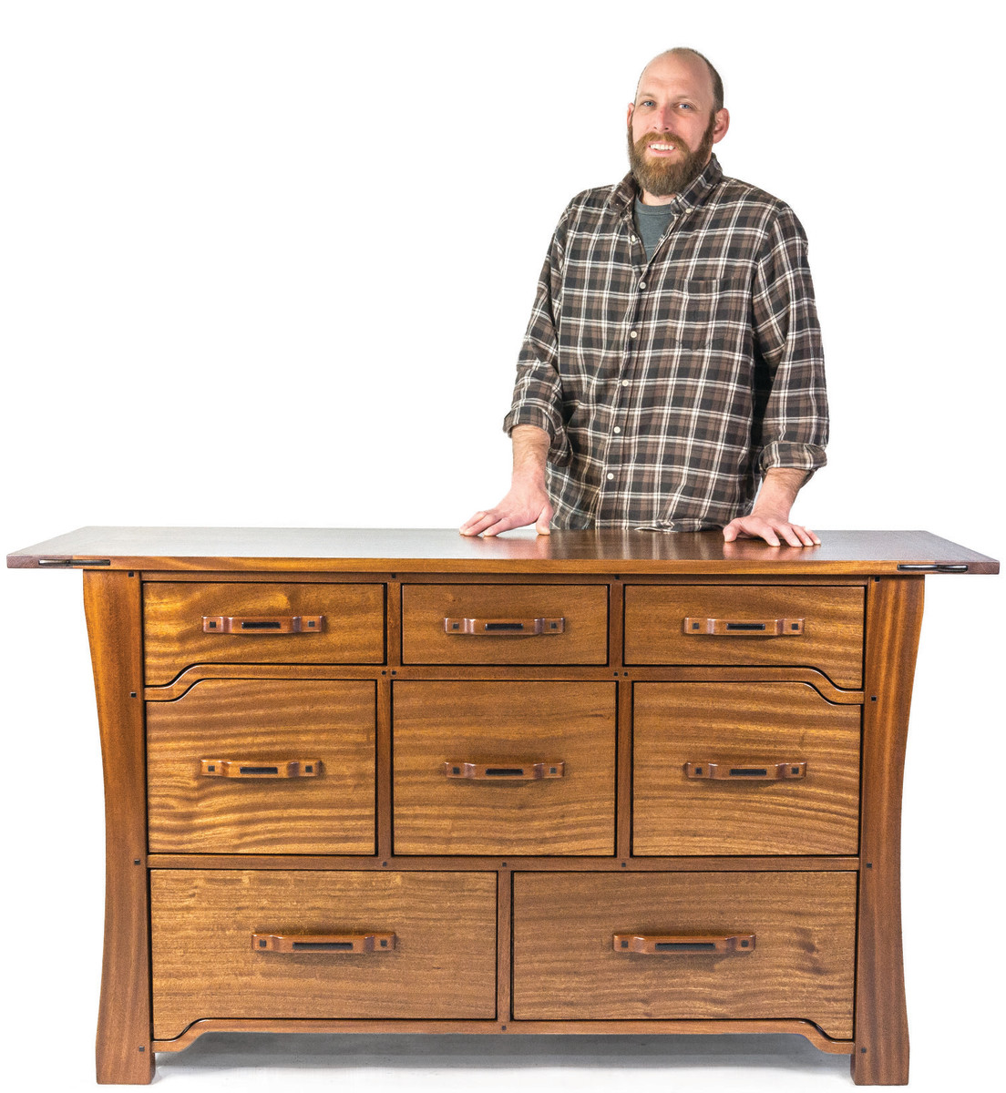 Brian Brace with a dresser made in the style of Greene & Greene, with a dye-stained, lacquered finish.
