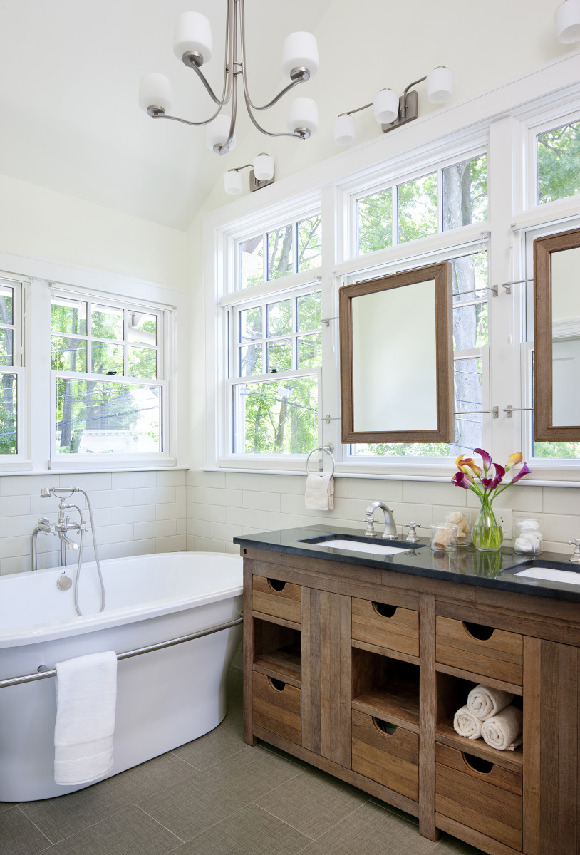 The new master bath is a handsome, comfortable space with classic fixtures and energy-efficient windows.
