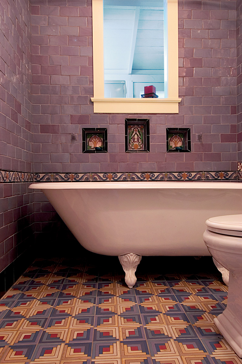 With lavender wall tiles, deco inserts, and a bold geometric tile floor, this recent bathroom by M.E. Tile has a '20s fun vibe.