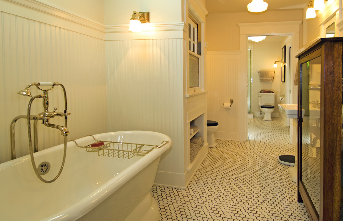 Two interconnected bathrooms fit right in; materials are the same as baths of the early 20th century.