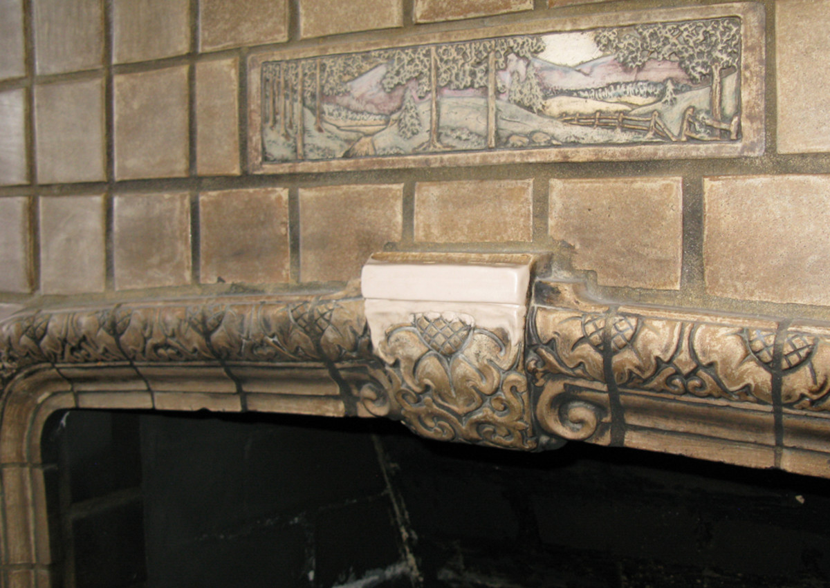 The fire surround's keystone tile had been sheared off, probably to make room for a fire screen. Epoxy reconstruction was guided by a historic Claycraft catalog.