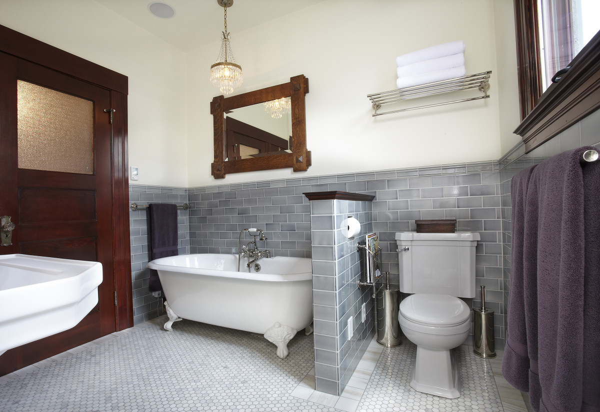 This timeless bathroom in a 1912 house is actually all new.