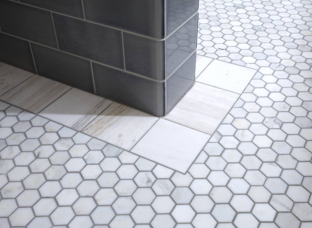 Hexagonal floor tiles and the unusual hand-cut border are marble, from Subway Ceramics.
