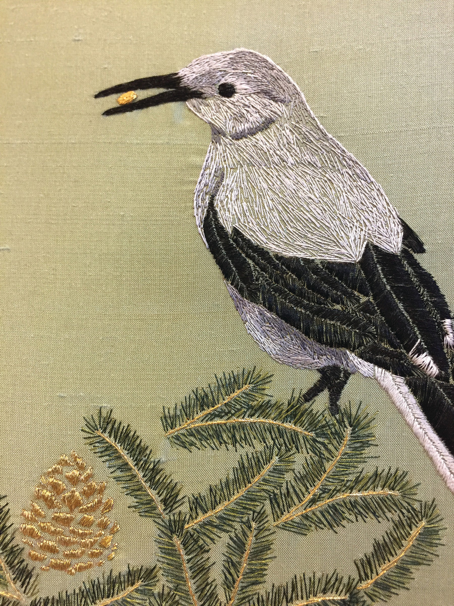 A panel detail from a screen exhibited at the Roycroft Campus in late 2018 depicts the Clark's nutcracker, the only species known to distribute the seeds of the oldest tree on Earth, the bristlecone pine.