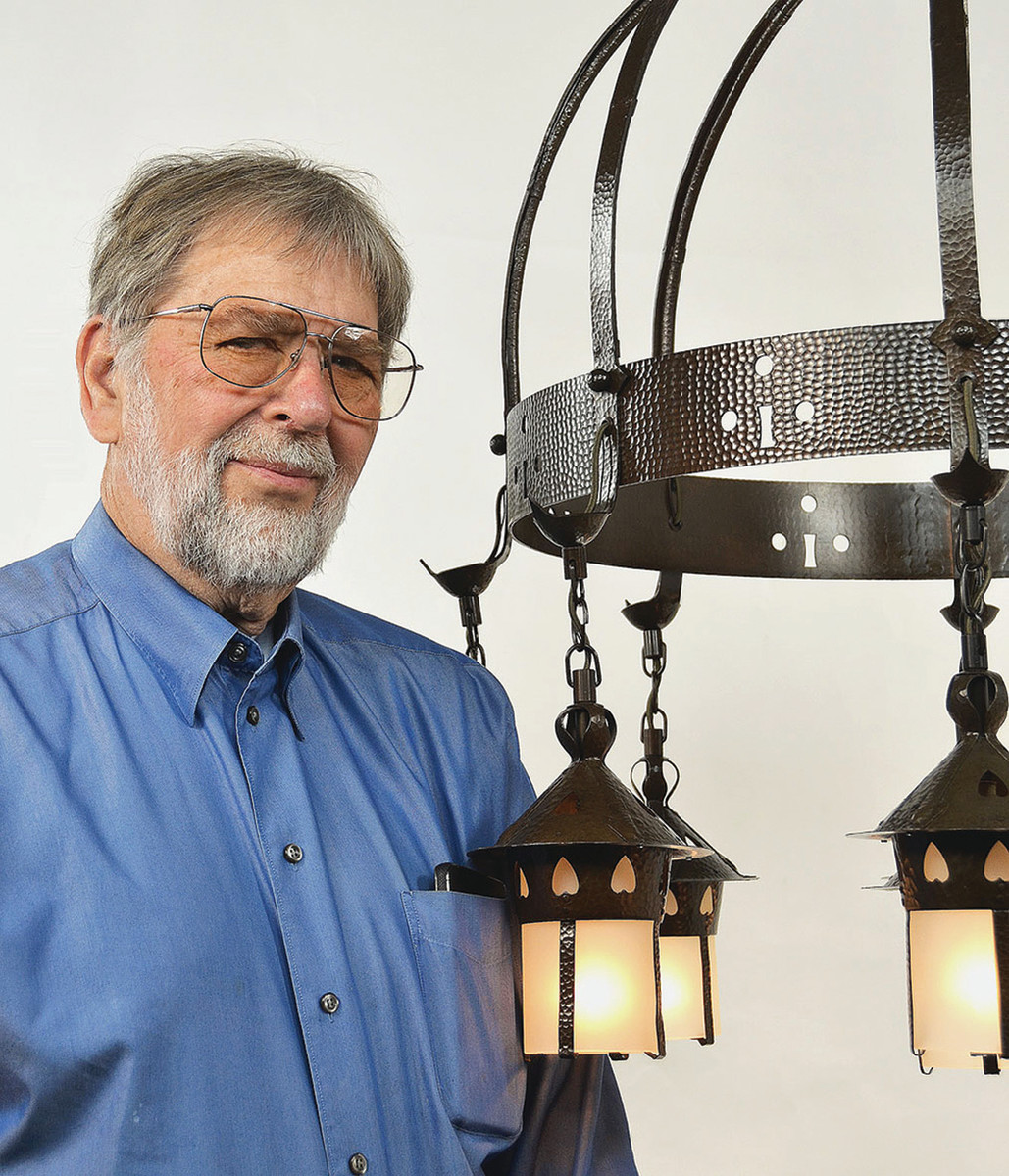 "Shown with Vintage's reproduction of a Stickley ""Heart'"" chandelier, Ken Kelly has been buying, selling, and reproducing historic lighting for more than 50 years."