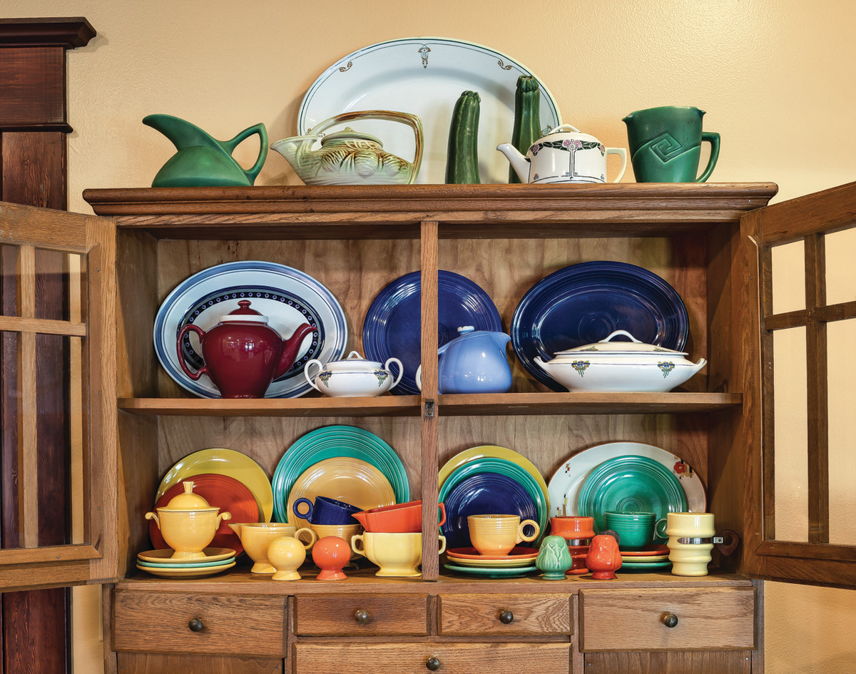 A 1920s kitchen piece is used as a china hutch in the breakfast area. Pottery includes (top) McCoy and Rookwood, (middle) teapots from Jill's mother along with McCormick and Hall pieces, and (bottom) vintage Fiesta from the early years of production, which started in 1936.