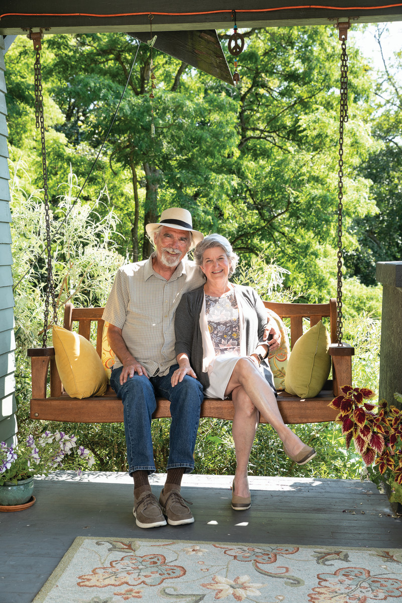 Homeowners Dean and Jill Sterrett relax on the porch swing, one of their first purchases for the house.
