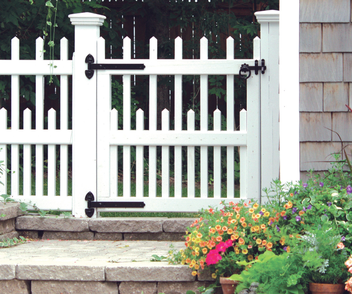 Gate latch and hinges by Snug Cottage Hardware lend a traditional look.