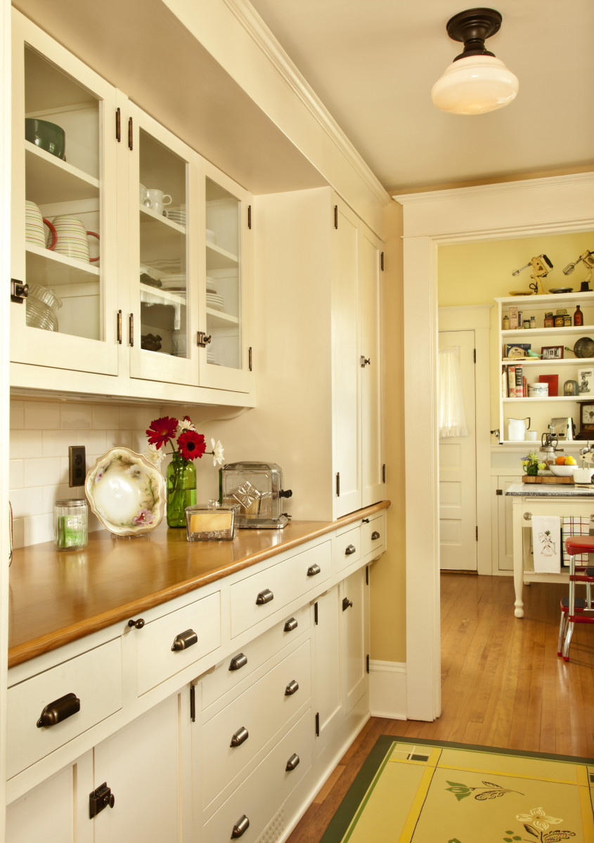 The original pantry, now restored, creates an L-shape with the kitchen.